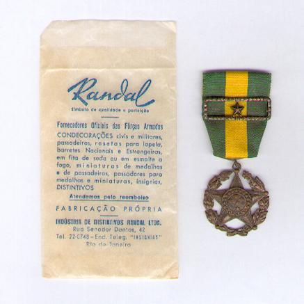 Military Medal, bronze (Medalha Militar de bronze) with star citation for ten years' service, in rare original envelope of issue by Randal of Rio de Janeiro