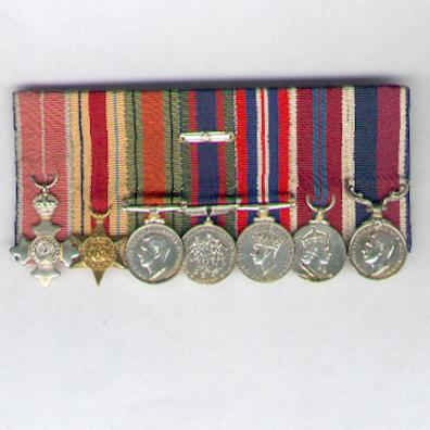 World War II R.A.F. court-mounted miniature group of seven: M.B.E., Military, Africa Star, Defence Medal, Canadian Voluntary Service Medal with maple leaf clasp, War Medal, Coronation Medal 1953 and R.A.F. Long Service and Good Conduct Medal
