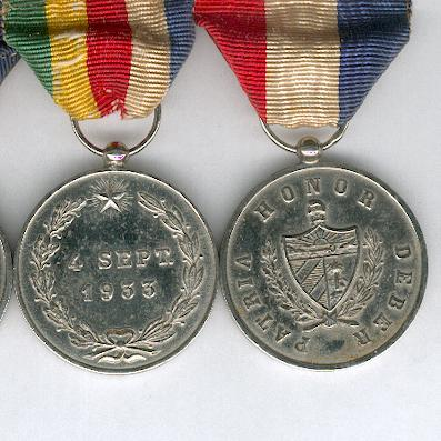 A rare pre-Revolution Group of Three in silver, probably mid-1930s