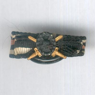 GERMAN EMPIRE.  Wound Badge, black, button-mounted on the ribbon of the Cross of Honour of the World War (Hindenburg Cross), Combatant, with Swords, miniature
