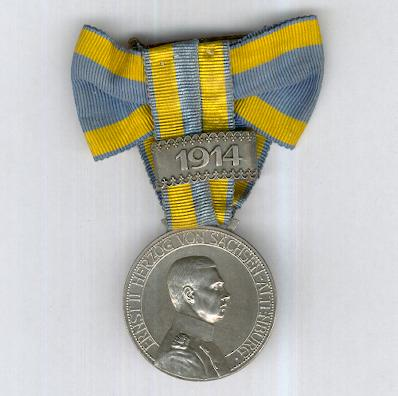 SAXE-ALTENBURG.  Duke Ernst Medal on ladies bow with '1914' bar (SACHSEN-ALTENBURG.  Herzog-Ernst-Medaille am Damenschleife mit Bandspange '1914')