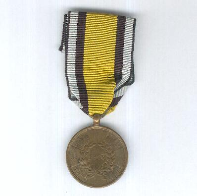 PRUSSIA.  Campaign Medal for 1813, cross with curved arm ends, made from captured cannon, on combatant's ribbon (PREUSSEN. Kriegs-Denkmünze für 1813, Kreuz mit gebogenen Armen, aus erobertem Geschütz, am Kämpferband)