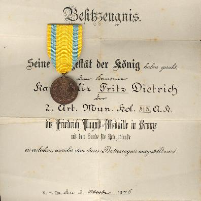 SAXONY, Kingdom.  Friedrich August Medal, bronze, on war service ribbon, with rare award certificate (SACHSEN - Königreich.  Bronzene Friedrich-August-Medaille am Band für Kriegsverdienste, mit selten Besitzzeugnis), 1905-1918 issue