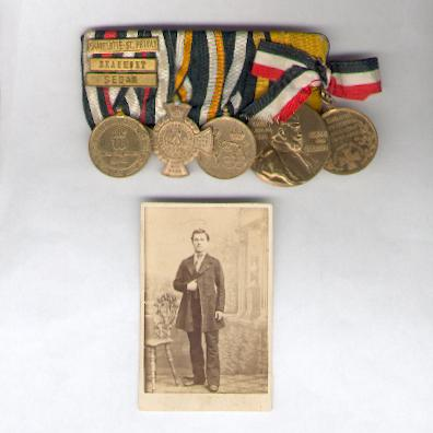 PRUSSIA.  Group of Five, Wars of 1864, 1866 and 1870-71 (PREUSSEN.  5er Ordenspange, Kriege 1864, 1866 und 1870-71), sold with an original photograph of the known recipient