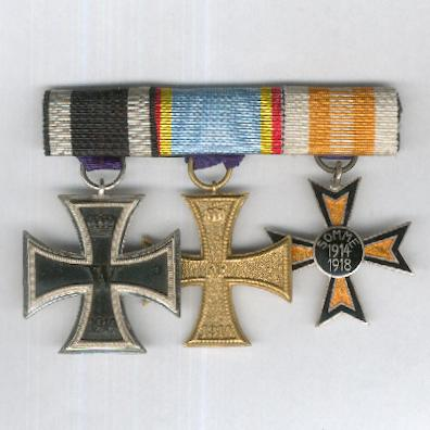 Great War Trio:  PRUSSIA Iron Cross, II class, 1914 issue; MECKLENBURG-SCHWERIN.  Military Merit Cross, II class, on combatant's ribbon and GERMANY.  Somme Cross, 1914-1918 by Fleck & Sohn of Hamburg, bar-mounted for wear