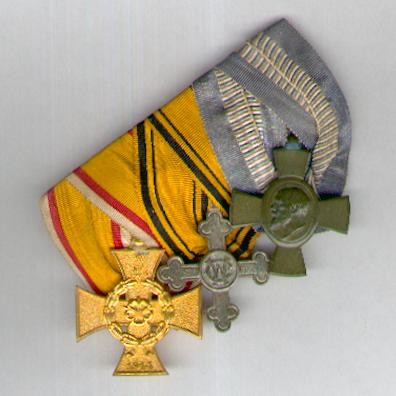 Great War Trio:  LIPPE-DETMOLD. War Merit Cross (Kriegsverdienstkreuz), WÜRTTEMBERG. Charlotte Cross (Charlottenkreuz) and BAVARIA. King Ludwig Cross (BAYERN. König Ludwig-Kreuze) mounted as a 'Frackspange' by J. Godet & Sohn, Berlin