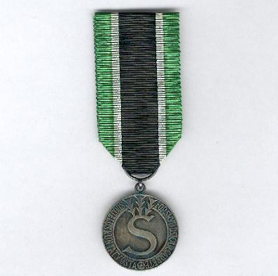 Civil Guard Medal of Merit (Suojeluskunnan ansiomitali), silver