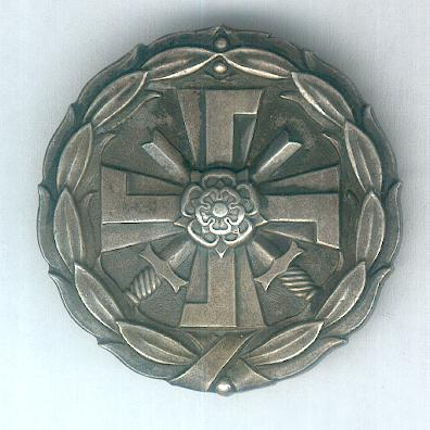 Badge for Disabled Military Veterans of the 1939-1945 War (Sotavammaismerkki 1939-1945) by Hopeajaloste Oy of Helsinki