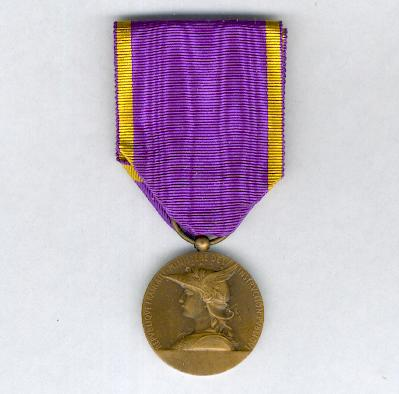 Medal for Primary Education, bronze (Médaille de l'Enseignement du 1er Degré en bronze)