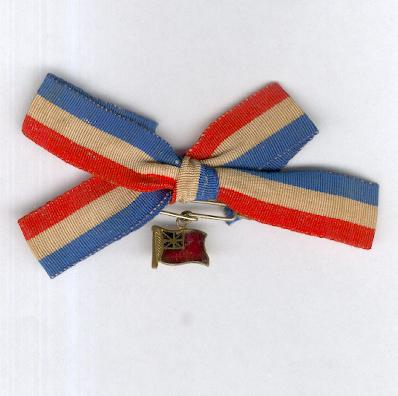 British Red Ensign insignia on French tricolour bow