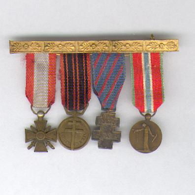 Mounted Miniature Group of Four: War Cross for Exterior Theatres of Operation, Medal of the Resistance, Medal for Voluntary Service in Free France and Medal for Civilian Prisoners, Deportees and Hostages of the Great War, 1914-1918
