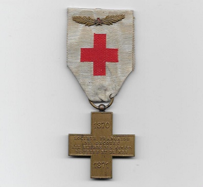 Cross of the French Society for the Aid of Wounded Military, bronze (Croix de la Société Française de Secours aux Blessés Militaires en bronze) on original embroidered ribbon with rare palm citation, Franco-Prussian War, 1870-71