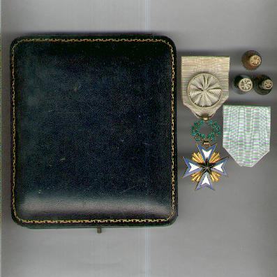 BENIN. Order of the Black Star, officer (Ordre de l'Etoile Noire, officier) with spare ribbon and three buttonhole rosettes of graduated size, in original privately-made fitted case