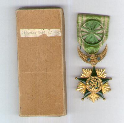 COMOROS.  Order of the Star of Grand Comoro, officer (Ordre de l'Étoile de la Grande Comore, officier), 2nd type, since 1910, in card case of Etablissement P. Delande, Paris