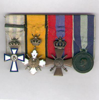 A rare World War II group of four, comprising: Order of Valour, gold cross, with '1940' bar; Royal Order of the Phoenix, knight's gold cross with crossed swords, 1941 issue; War Cross of 1940, III class; Commemorative Medal for the War of 1940-1941