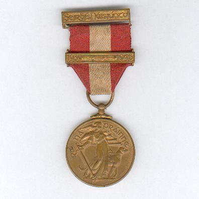 The Emergency Service Medal, Local Security Force (An Bonn Seirbhíse Éigeandála, Na Caomnóirí Áitiúla), 1939-1946, with '1939 - 1946' bar, by P. Quinn Ltd. of Dublin