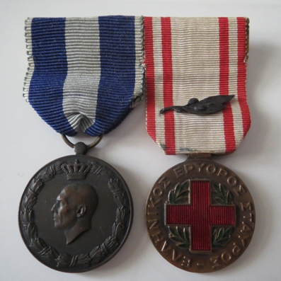 World War II Pair comprising Commemorative Medal for the War of 1940-1941, Land Operations and Hellenic Red Cross Medal, 1940-1941 with citation on the ribbon, mounted for wear