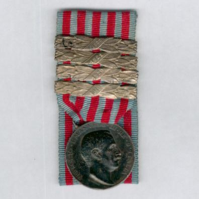 Commemorative Medal for the Libyan Campaign, silver, (Medaglia Commemorativa delle Campagne di Libia, argente) by Regio Zecca, court-mounted with '1919', '1920', '1921' and '1922' bars