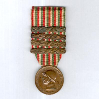 Commemorative Medal for the War of 1915-1918 (Medaglia Commemorativa della Guerra 1915-1918) by M. Nelli Inc. of Florence, with '1915', '1916', '1917' and '1918' bars