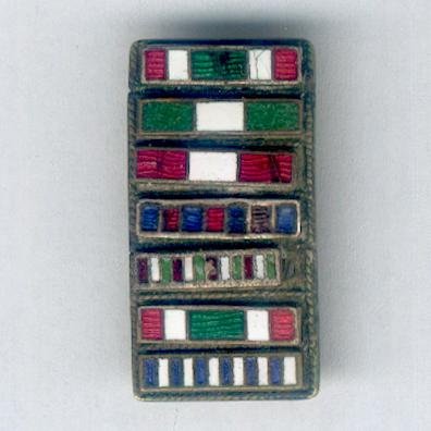World War I and earlier enamel lapel ribbon bar with seven awards of a long-serving army officer, mounted for wear