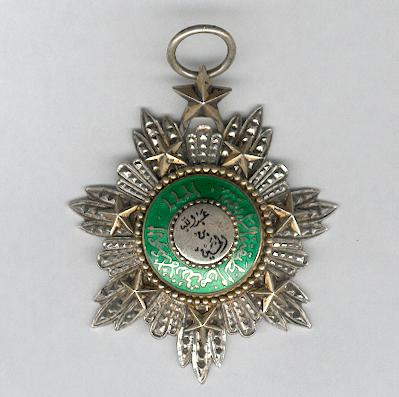 Order of the Star of Jordan (Wisam al-Kawkab al-Urdani), Grand Officer, neck badge, silver and enamel, hallmarked and maker's mark 'Garrard and Co.'