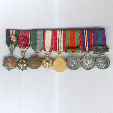 A Very Rare, Probably Unique World War II and Palestine Miniature Group of Eight: Order of the Renaissance III class, Order of Independence III class, China Order of the Cloud and Banner II class, two Jordanian Medals and three British Medals