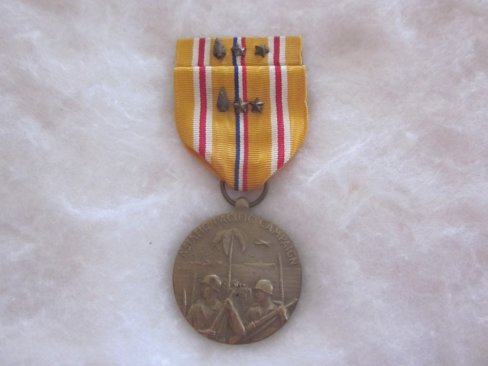 Asiatic-Pacific Campaign Medal, 1941-1946, with ribbon bar, both with spearhead and two star citations
