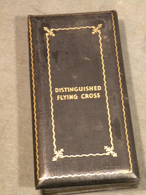 Distinguished Flying Cross, numbered, with ribbon bar and enamel lapel bar in World War II vintage case of issue