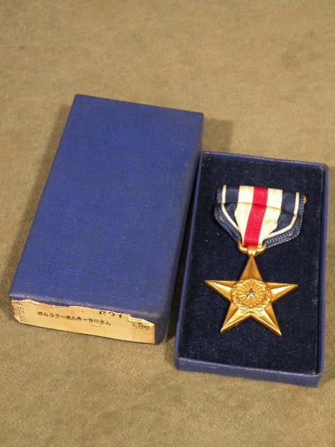 Silver Star Medal, numbered,  in World War II vintage pasteboard case of issue