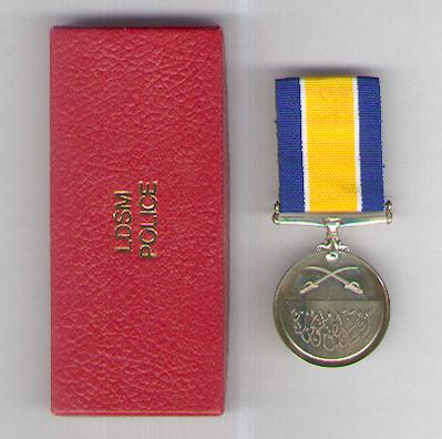 Long and Distinguished Service Medal, silver, on Police ribbon, in fitted embossed case of issue, by Spink & Son Ltd. of London