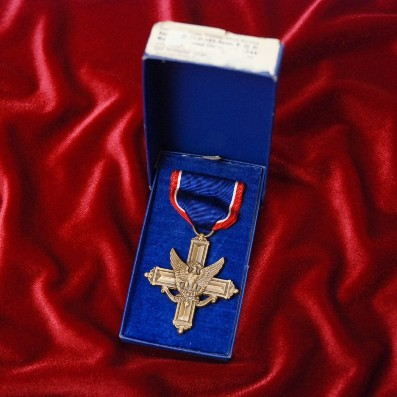 Distinguished Service Cross in its blue box of issue by the Robbins Company of Attleboro, Mass., World War II era