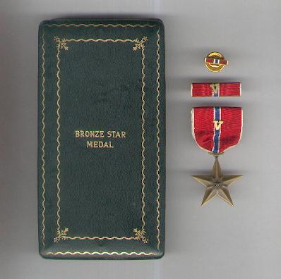 Bronze Star Medal with Combat Distinguishing 'V' Device on the ribbon and with ribbon bar and enamel lapel bar, in World War II vintage case of issue