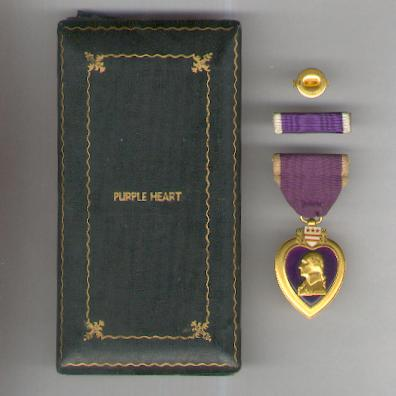 The Purple Heart  with ribbon bar and enamel lapel bar in World War II vintage case of issue