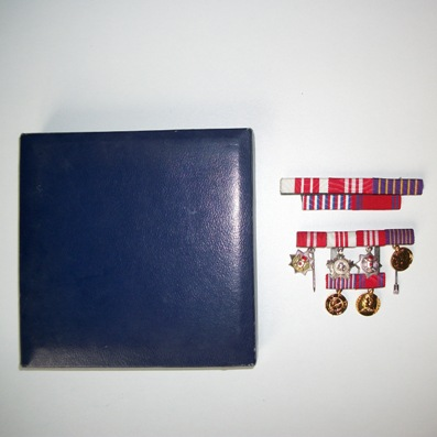 Group of six miniatures and ribbon bar: Orders of Military Merit with Gold and Silver Sword, Order of the People's Army with Silver Star, Medals for the 30th and 40th Anniversary of the Yugoslav People's Army and 30 Years of Victory over Fascism, cased