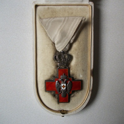 Balkan War 1913 Pair to Dr. Max Bjørn Rosenthal of Denmark: Red Cross of Serbia, Silver Cross, royal type, by Jacob Leser of Munich and Medal for Victory by Emilio Sacchini of Milan, both in fitted cases of issue; with thirteen associated images