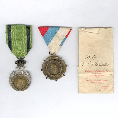 Great War Pair: Commemorative Medal for the Albanian Retreat 1915 and Commemorative Cross for the War of 1914-1918 with original Huguenin Frères envelope to Captain S. T. McCabe, Royal Irish Rifles
