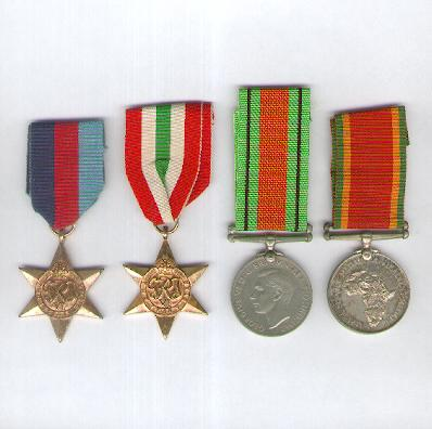 World War II Group of Four: 1939-1945 Star, Italy Star 1943-1945, Defence Medal, 1939-1945 and Africa Service Medal, 1939-1945, all attributed to 216364 C. F. J. Tylcoat