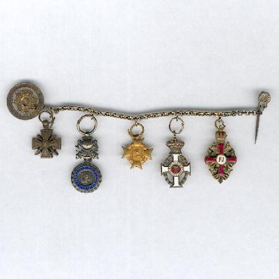 Group of five French, Greek and Imperial Austrian miniatures, chain mounted for wear