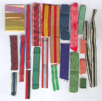 Assorted Belgian, French, German and Italian miniature ribbons together with a card of French 'rappel' threads
