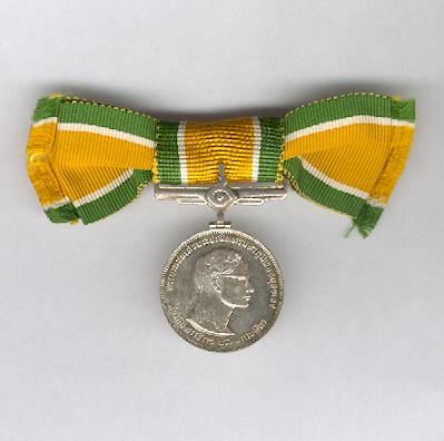 Commemorative Medal for the Silver Jubilee of His Majesty the King, 2514 BE (1971 AD) on original ladies' bow