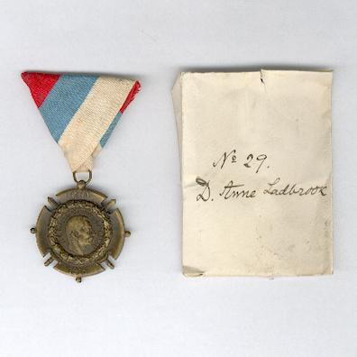 Commemorative Cross for the War of Liberation and Union, 1914-1918 by Huguenin Frères, Le Locle, with envelope inscribed 'No. 29 D. Anne Ladbrook' for Sister Deborah Anne Ladbrook, Territorial Force Nursing Service who was awarded the Royal Red Cross for services in Salonika