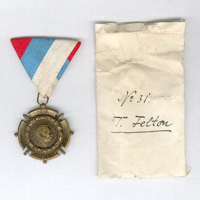 Commemorative Cross for the War of Liberation and Union, 1914-1918  by Huguenin Frères, Le Locle, with envelope inscribed  'No. 31 T. Felton'